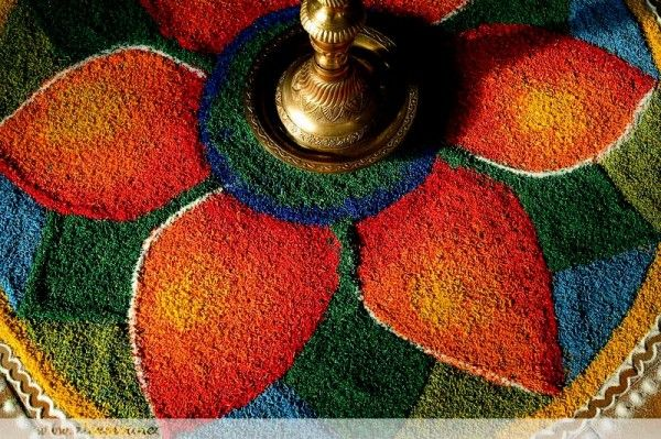 Gorgeous rangoli with brass lamp in the middle - would be great to feature this somewhere, like next to place cards and/or gift table.