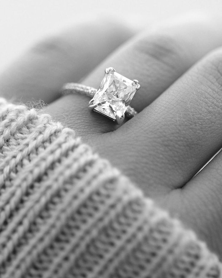 This conflict-free diamond engagement ring is named the Socialite and holds a 3.0 carat radiant center stone