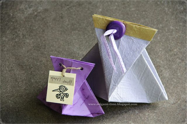 Small origami gift bags.  Video tutorial here: http://www.youtube.com/watch?v=yHtWl1cGa6I=related