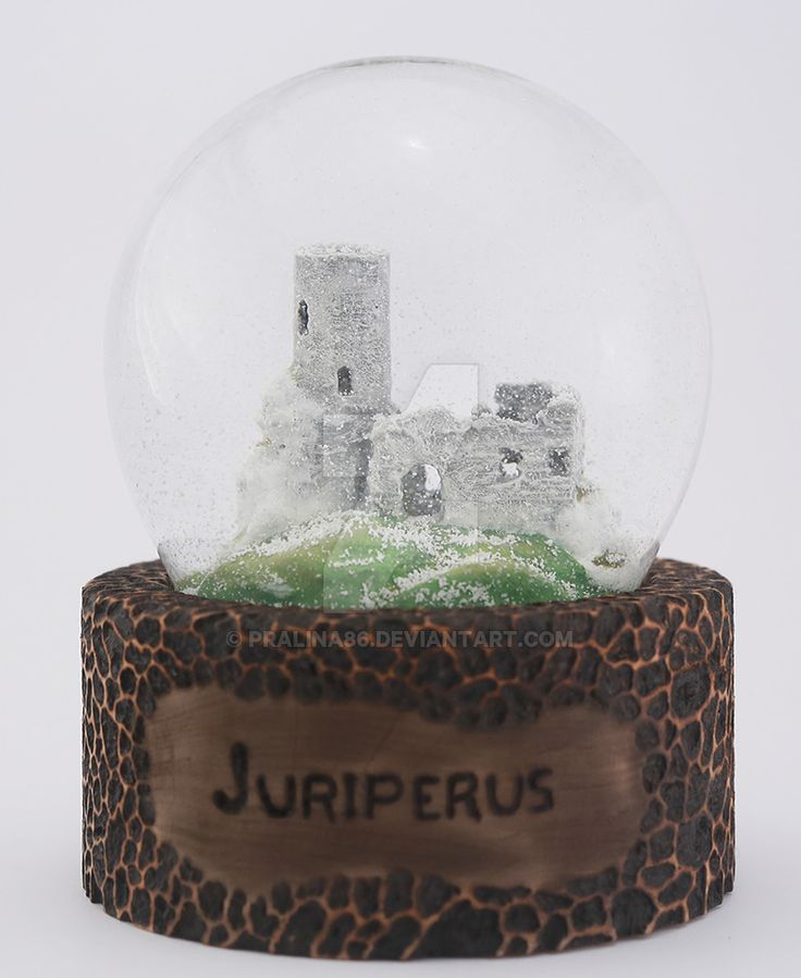 Juriperus manufacture three-dimensional logo, sealed in a snowball. Ruins in the snow.