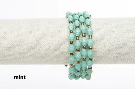 Ssanyu bracelet - mint.  This wrap around bracelet was named Ssanyu,by the women, meaning Joy. It is also a name given to women. Hand rolled paper beads strung on metal cording, wrap happily around your wrist two or three times. No need for a fastener.