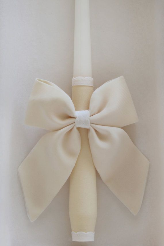 A #candle #decorations used in #baptism, #confirmation and #communion. • Suitable for #boys and #girls.  • #Decorated with #Ivory #color chiffon# bow, • Measurements: