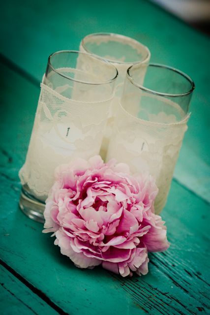Easy, elegant wedding idea: lace around cylinder glasses with tea light or votive as decoration. | Perfect Shabby Chic Wedding Reception