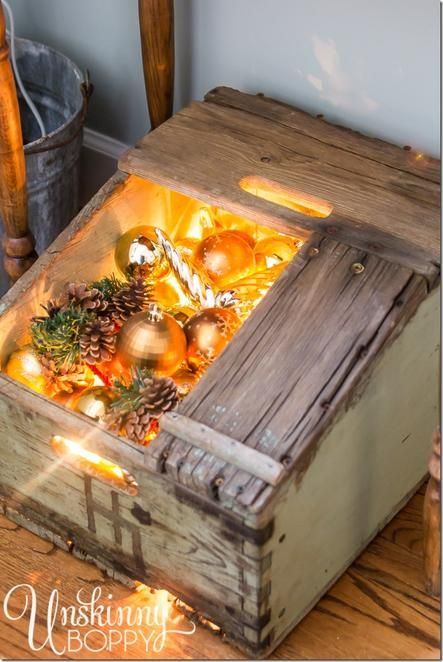 Fill an old rustic box with ornaments and a strand of lights for an instant holiday decoration.Old Boxes, Home Tours, Rustic Christmas Decorations, Decor Ideas, Rustic Boxes, Christmas Lights, Holiday Decorations, Wooden Boxes, Instant Display