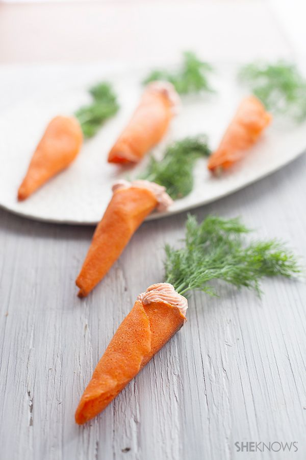 """Carrots"" with salmon mousse! Crispy wafer cones are filled with a goat cheese salmon mousse and topped with a sprig of dill"