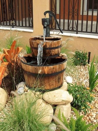 This is a whskey barrel fountain that Greenday Creations put inside a rock garden. Its a small fountain that adds the sounds of water to a quite landscape.