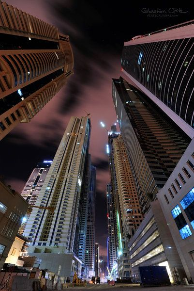 """""""The Giants' Alley""""  -- Dubai.....  walk amongst  what will be """"The Tallest Block on the Planet"""". All these buildings will eventually have between 80 and 120 floors"""