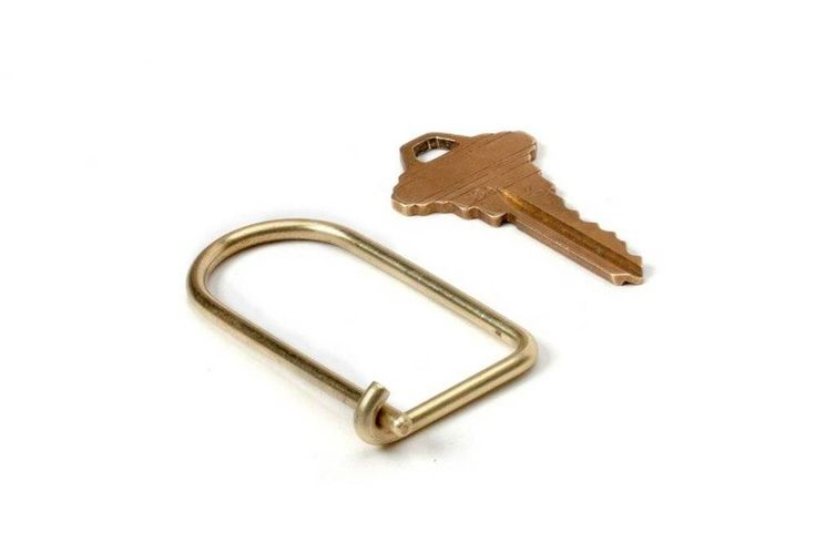 """<div><span style=""""font-family: Calibri; font-size: 110%;"""">A simple and efficient brass keyring. The inherent strength of the brass wire creates a secure closure. Holds more keys than you will likely ever own.</span></div>"""