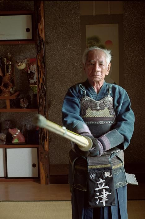 JAPAN. Tokyo. Miyako Jima Island. 82 year old ex-teacher, Mr Tokio Tatetsu still practises Kendo 3 times a week. He does not drink but smokes about 5 cigarettes a day. 2001 / Chris Steele-Perkins