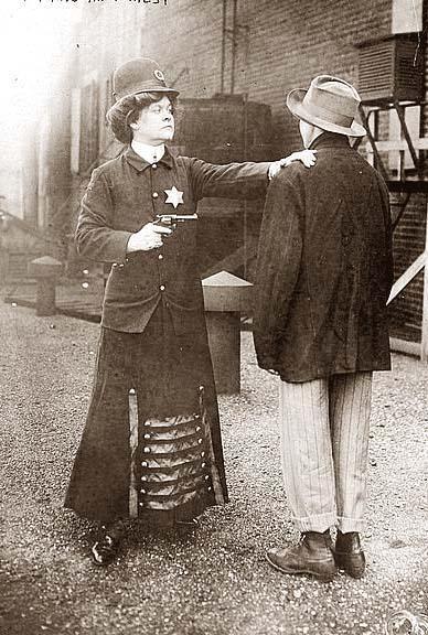 Suffragette posed in police uniform to illustrate woman police concept, Cincinnati, Ohio: 1909