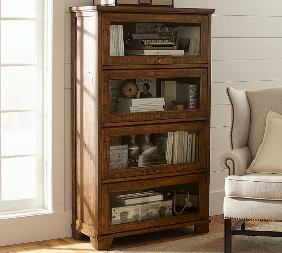 Closed bookshelf with glass front lift doors! Like a ...