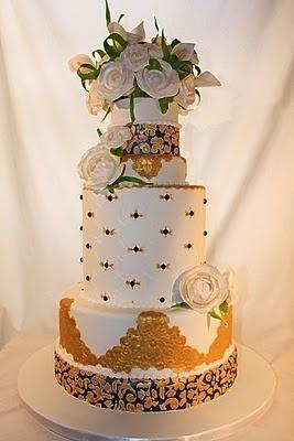 Elegant royal blue and gold wedding cake