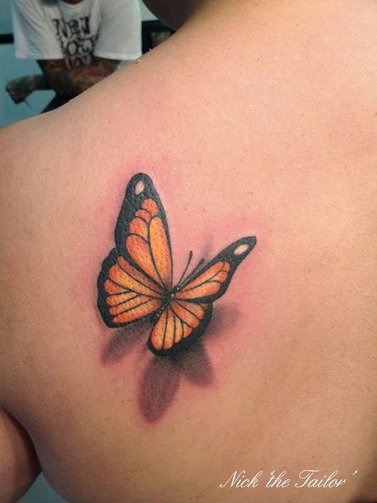 Orange 3D butterfly on the shoulder.