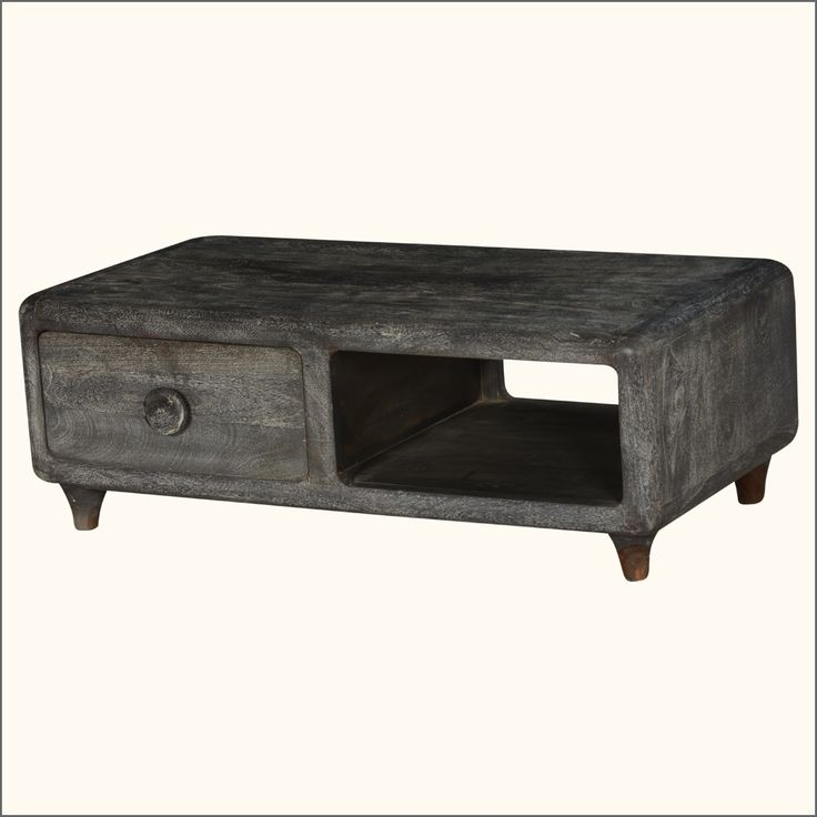 Are you searching for a rustic and romantic entertainment island built for today's equipment? Take a look at our Smokey Pioneer Rustic TV Console. This solid hardwood media cabinet stands off the floor on short, tapered legs has an open front and back shelf, and a convenient drawer. This television console is built with rounded corners and features a dynamic swirling grey stain and finish. The entertainment cabinet has a dynamic swirling wood grain design. It is built with solid mango wood…