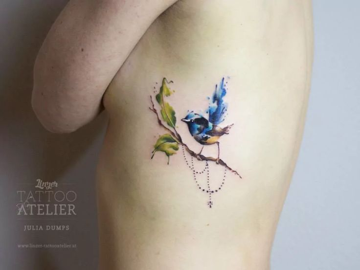 Beautiful bluebird on a leafy branch #tattoo by Julia Dumps. | via tattoodo.com