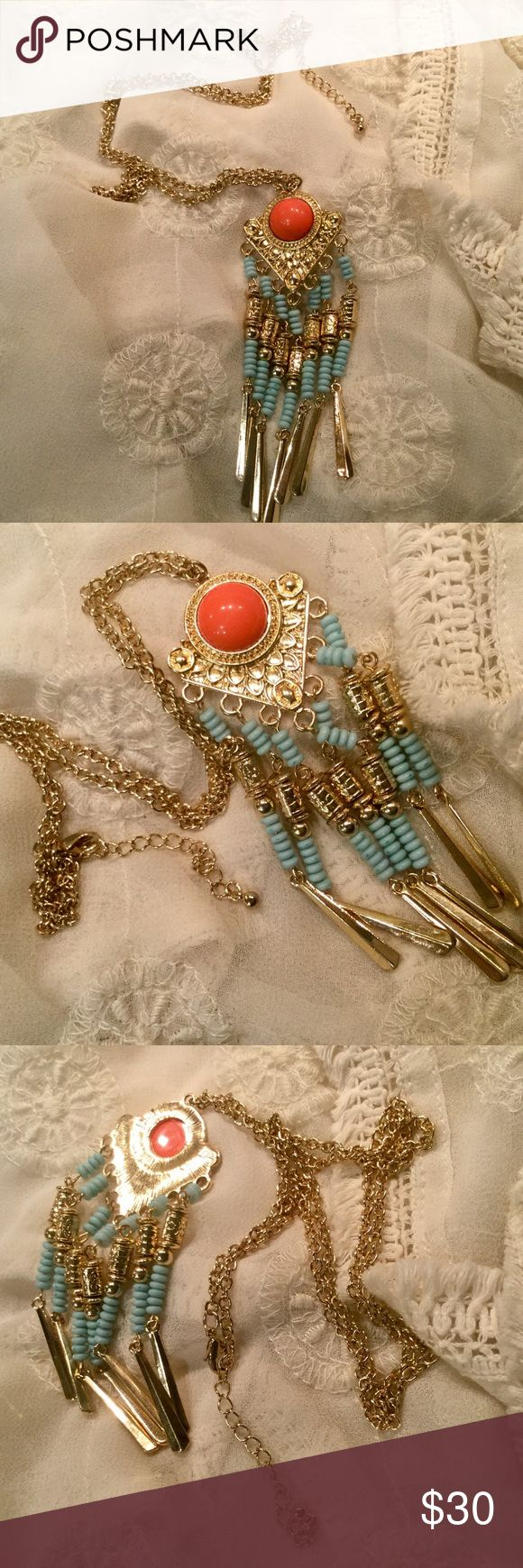 "Charlotte Russe Aztec Gold Aqua Turquoise Necklace 28"" long chain with 2 1/2"" extender.  4 1/2"" long Aztec pendant of gold, round orange bead. And turquoise and gold bead fringe. One pic shows the back of the pendant. NEW never worn Charlotte Russe necklace. Gorgeous. Charlotte Russe Jewelry Necklaces"