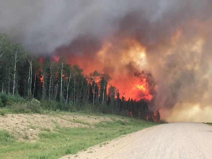 June 29, 2015 | Raging fire on Highway 969 in Saskatchewan on June 29, 2015 | photo taken by Highway Hotline crews.