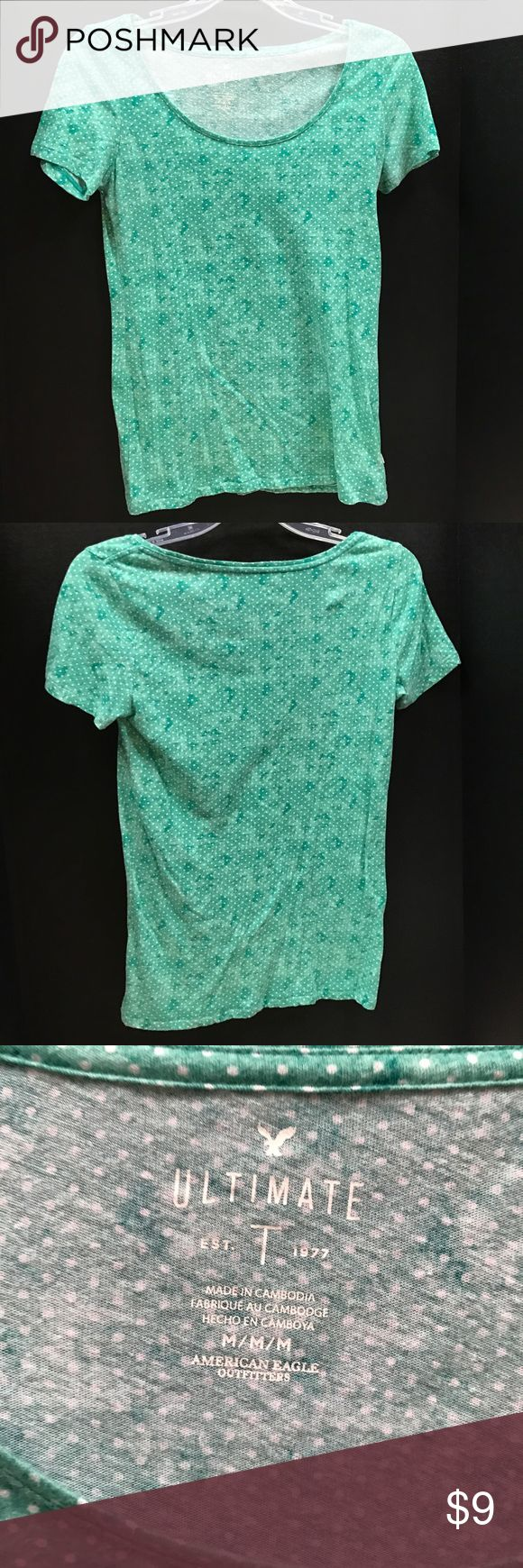 American Eagle Polka Dot Shirt This green shirt with white polka dots is by American Eagle. There are no problems with the garment. Feel free to make an offer or bundle! American Eagle Outfitters Tops Tees - Short Sleeve