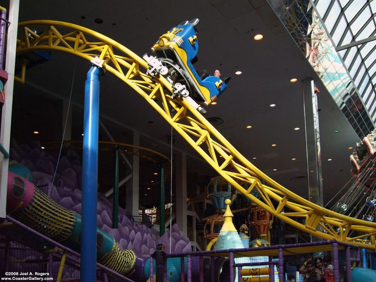 "Galaxy Orbiter: Galaxyland Amusement Park indoors at the West Edmonton Mall in Canada. This exciting ""spinning"" roller coaster is nearly 1,500 ft long and takes riders on a wild ride descending from 44 ft to reach a top speed of 30 mph. Galaxy Orbiter's specially designed four-passenger cars spin like toy tops throughout the ride. Since the spinning of the roller coaster cars is uncontrolled, each ride on Galaxy Orbiter should be a one-of-a-kind roller coaster experience."