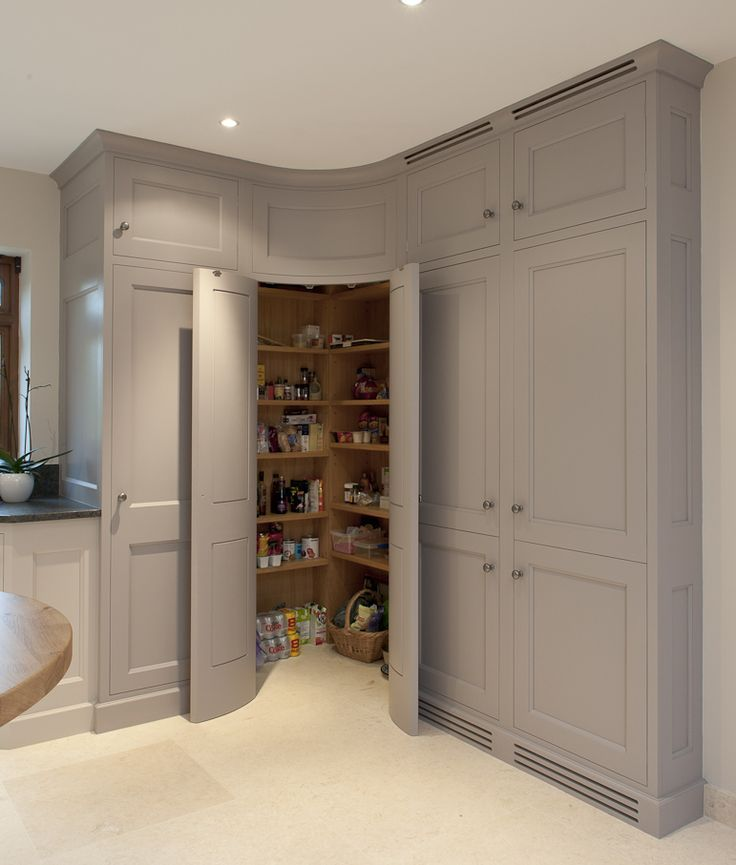 1- Full doors to a pantry, with storage wall w. full doors beside pantry door opening. | At The Ranch- kitchen & dining