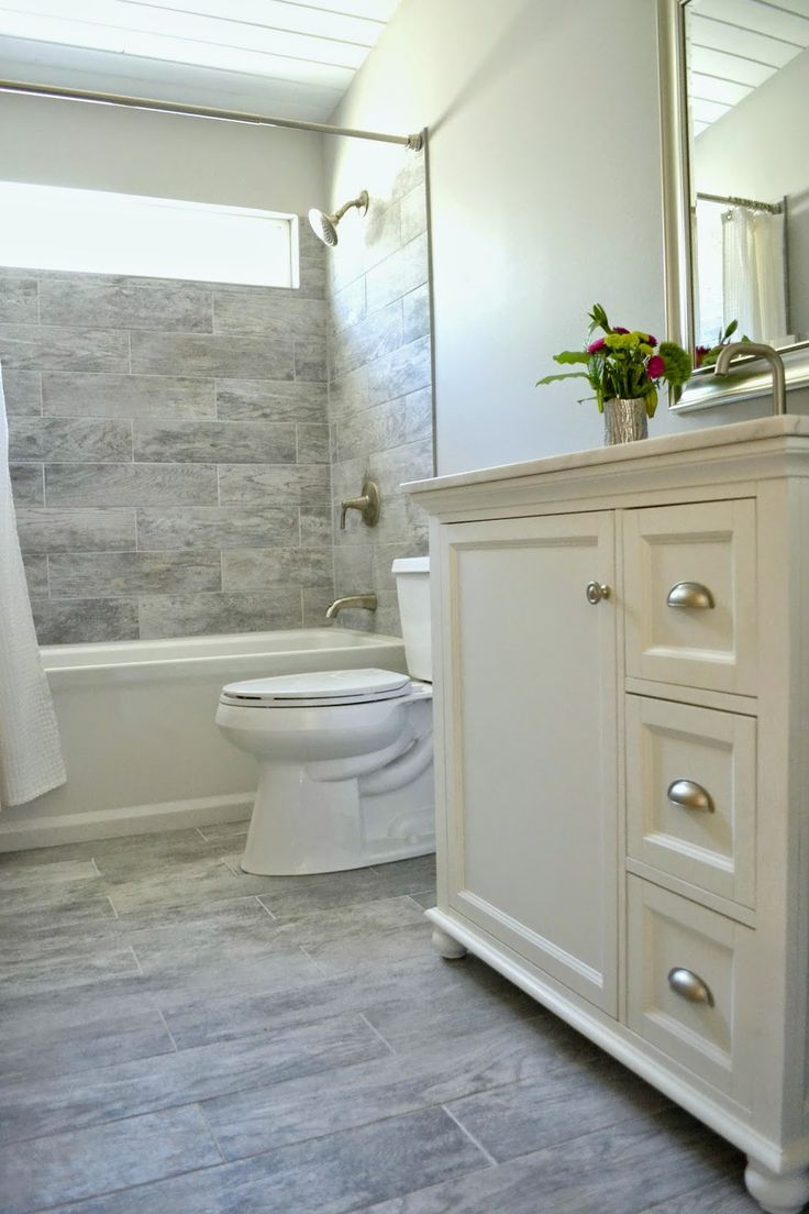 Like the tile that looks like wood inspire it bathroom for Grey wood floor bathroom