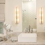 Harry Braswell Inc - bathrooms - cream bathroom, master bath, master bathroom, cream walls, cream bathroom walls, arabesque tile, white arabesque tile, arabesque tile backsplash, arabesque shower surround, arabesque shower tile, arabesque bathroom tile, arabesque tile shower, arabesque tile shower surround, frameless mirror, rectangular mirror, frameless rectangular mirror, modern sconces, bathroom sconces, vessel sink, vessel bathroom sink, bathroom vessel sink, modern faucet, cream vanity…