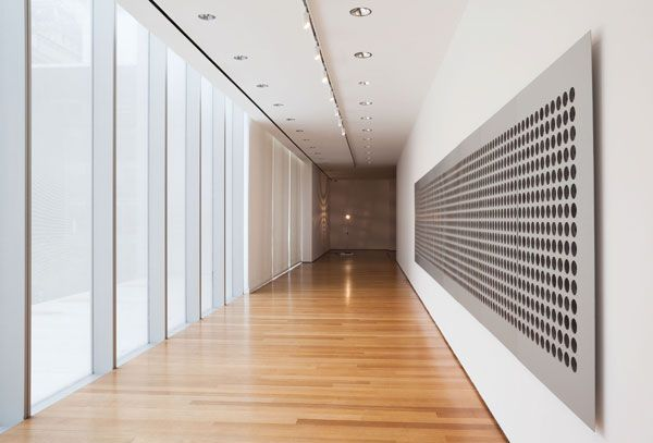 Installation view of Tristan Perich's Microtonal Wall, 2011, at the Museum of Modern Art. TOP: JONATHAN MUZIKAR/©2013 MUSEUM OF MODERN ART, NEW YORK/Courtesy the artist and bitforms gallery, new york