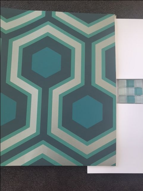 Selecting wallpaper for the Master Bedroom highlighting the lovely greens used in the ensuite tiles