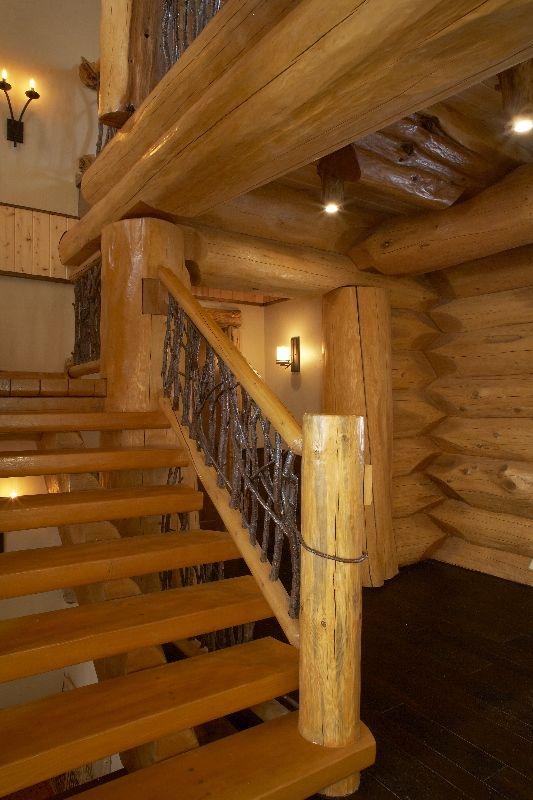Custom log home designed by Madison, WI based residential designer Udvari-Solner Design Company. Photo by Dale Hall