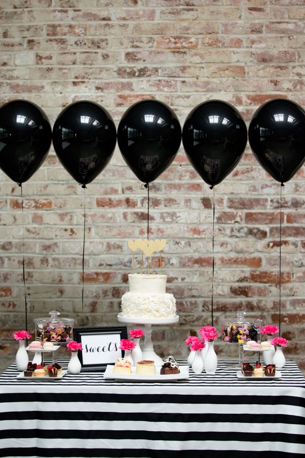 Love the theme, pop of pink and the brick wall! Choose your graduation party venue wise and it will become part of the decorations!
