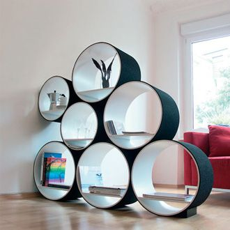 Modular Circle Shelving. Kinda fun maybe for a kid's room. I would look for concrete casting forms of various sizes and paint them the colors of the room.