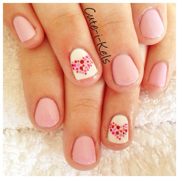 Pastel pink shellac over short natural nails with multi-coloured freehand love heart nail art... www.facebook.com/cuteikels