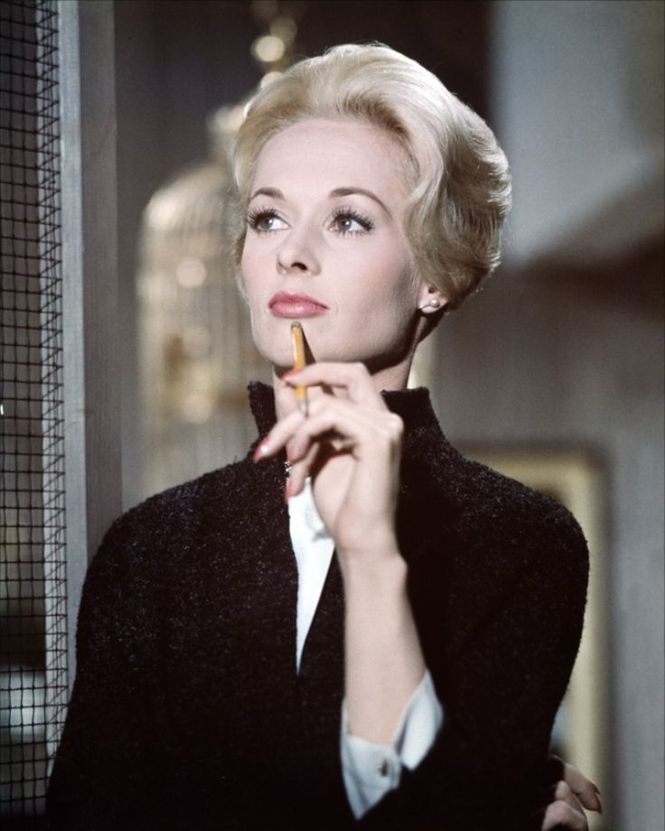 """Tippi Hedren gets a light on the set of """"The Birds"""" between takes. Description from pinterest.com. I searched for this on bing.com/images"""