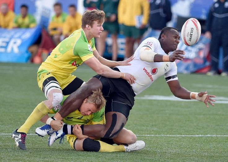... Kingston of Australia tackle Pio Tuwai of Fiji during the Cup Final at the USA Sevens Rugby tournament at Sam Boyd Stadium on March 6, 2016 in Las Vegas ...