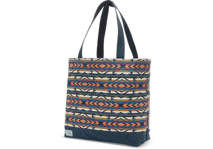 This printed canvas tote is the perfect balance of color, simplicity and tradition.