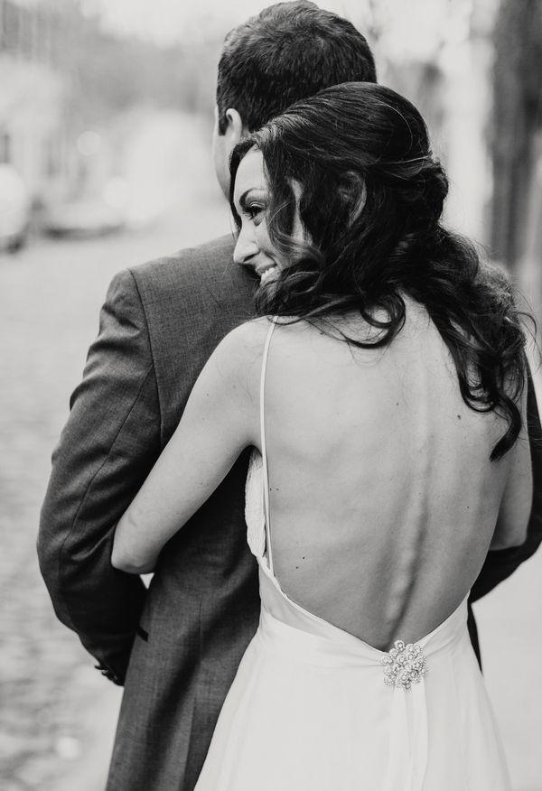 Open back wedding gown, brooch, modern elegance // Hyer Images