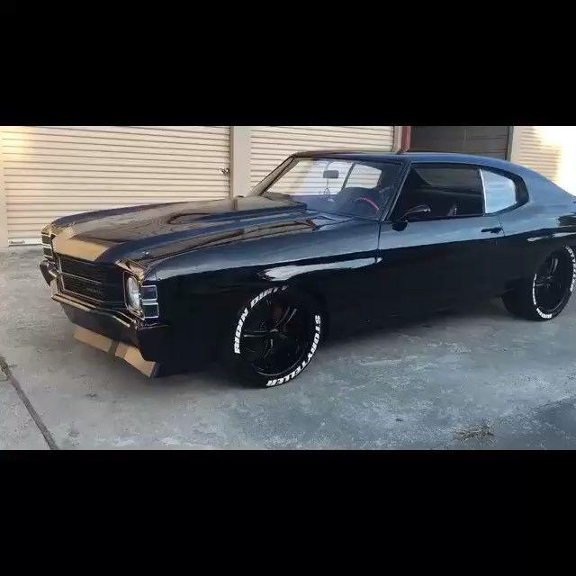 video clip of 71 chevelle all black, raised white letter tires, spoiler