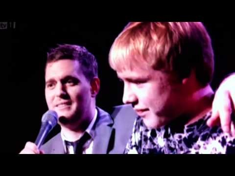Kid's mom stops Michael Buble and tells him about her son's talent.  Buble's reaction when the kid starts to sing is PRICELESS!