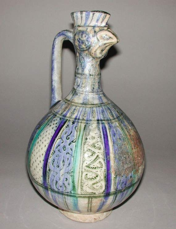 Title:    Cock-spouted Ewer    Maker:    Unknown    Collection:    Frank Brangwyn Collection    Category:    fritware (stonepaste)    Name(s):    ewer  Islamic pottery; category  underglaze painted ware; category    Date:    circa 1200 — circa 1399    School/Style:    Il-Khanid    Period:    13th-14th Century