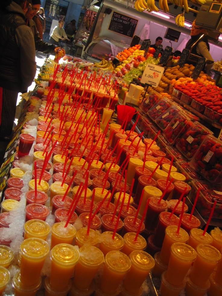 Fruit & Veg Markets in Spain -rows of fresh juices.