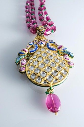 Exceptional Two sided Diamond Polki pendant with Pink Enamel by Suranas Jewelove, Jaipur. http://www.suranasjewelove.com/shop#!/~/product/category=4303062=18813299