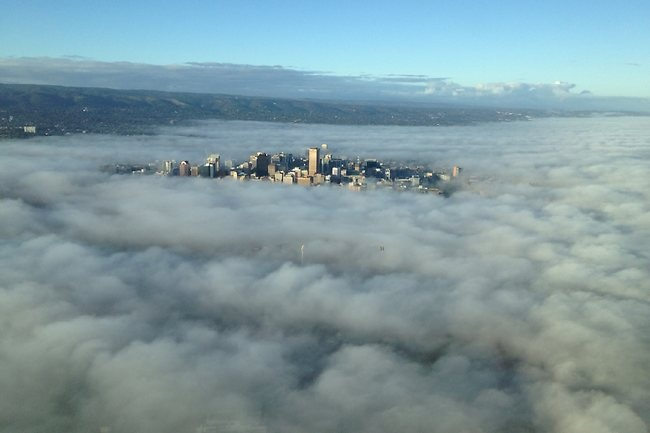 Adelaide city centre poking through the clouds