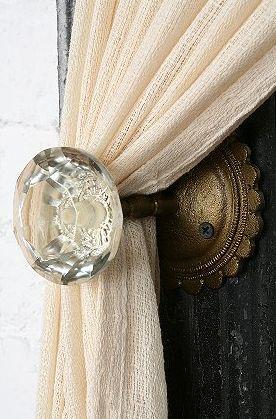 Crystal door knobs as curtain hook.  I love doorknobs!!