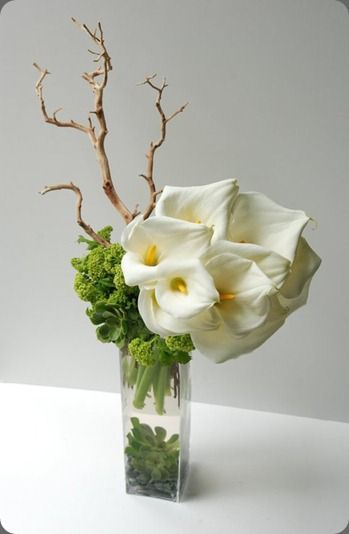 Calla lily flower arrangement  Seed Floral www.tablescapesbydesign.com https://www.facebook.com/pages/Tablescapes-By-Design/129811416695