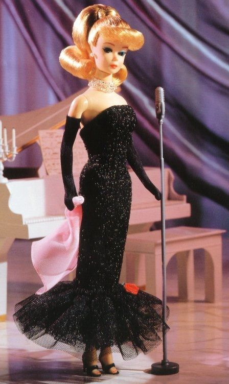 Solo in the Spotlight Barbie (1960).  This was my favorite outfit for my Barbie. My Barbie had a black bubble cut.  She looked fabulous in this dress. Debbie
