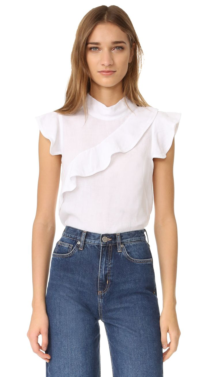 ¡Cómpralo ya!. Mcguire Denim Sorbonne Top - White. An angled ruffle lends subtle asymmetry to this breezy linen McGuire Denim top. Short sleeves. Button closures in back. Fabric: Lightweight weave. 100% linen. Dry clean. Made in the USA. Measurements Length: 20.75in / 53cm, from shoulder Measurements from size S. Available sizes: L , topcorto, croptops, croptop, croptops, croptop, topcrop, topscrops, cropped, topbailarina, corto, camisolacorta, crop, croppedt-shirt, kurzestop, topcorto…