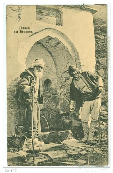 Two men at a public fountain. Istanbul, late 19th century.