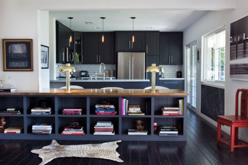 white walls, dark cabinets and floor