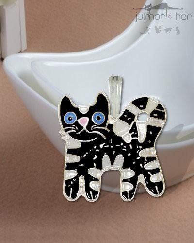 A whimsical black and white cat shaped pendant designed by Julie Mammano.  This colourful jewellery piece has been hand painted with enamels by talented artists to create an outstanding silver plated pendant with complimentary 450mm silver chain included. Free Express Shipping within Australia
