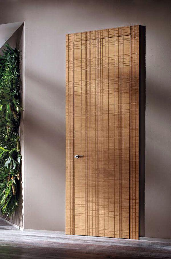 На фотографии бронированная дверь фабрики Barausse каталог 2010 Le Porte Di Barausse.pdf модель Miele Graffiata P страница 132